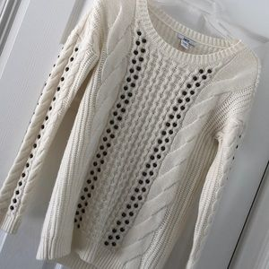 Beautiful sweater with rivet detailing.